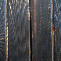 A Detailed View Of A More Heavily Brushed Section Of Charred Siding