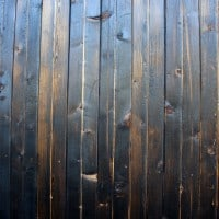 A Section Of Siding That Has Been More Heavily Brushed, Revealing More Grain And Wood Color