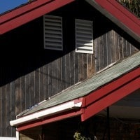 A Vertical View Of Deep Char Siding And The Roofline Of A Bend, Oregon Home.