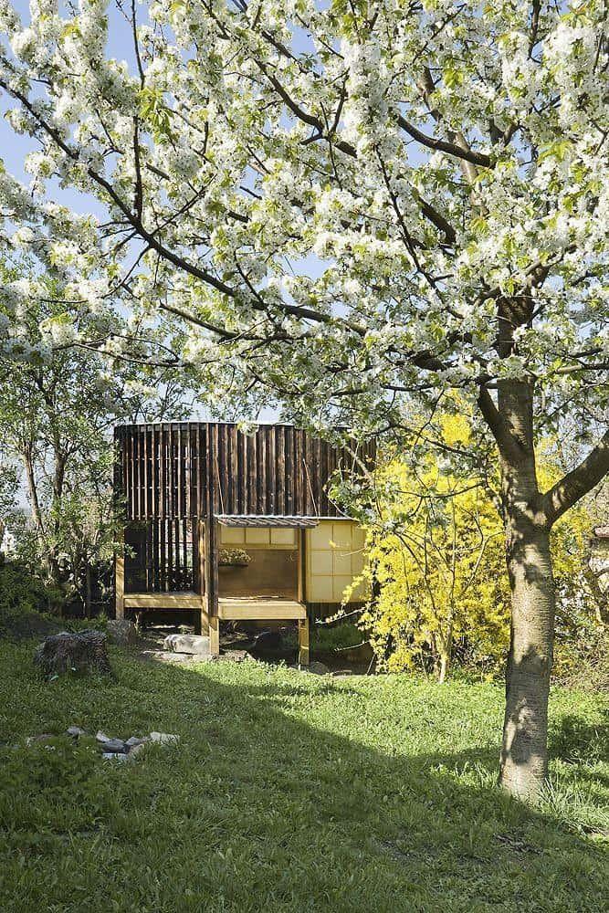 A garden teahouse with medium-char charred wood siding.